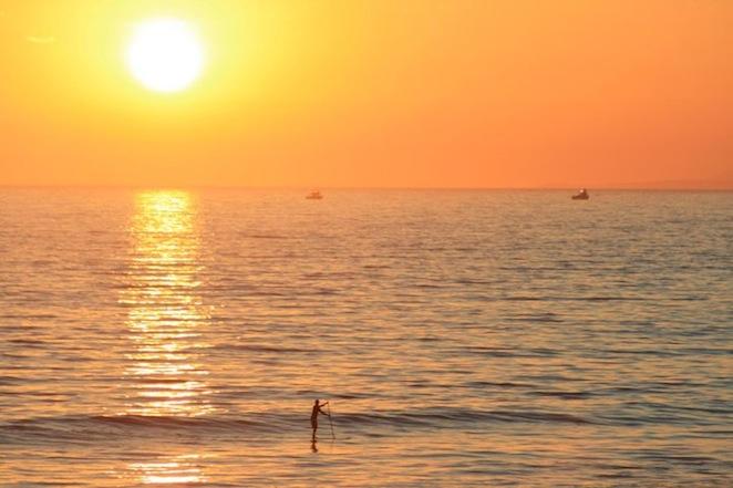 Standup paddleboarder sunset