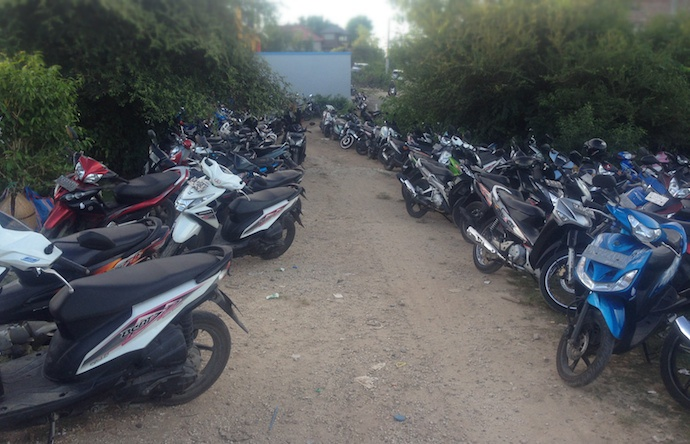 motor bikes lined up leading to the clearing in the jungle