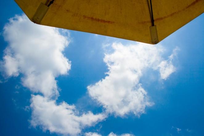 bali sky and umbrella