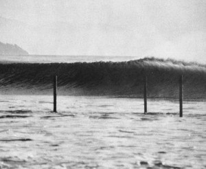 poles and surfing wave at campus point in isla vista