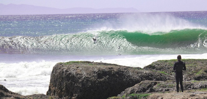 surfer at campus point ucsb isla vista